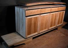 """The Martins custom audio cabinet built from maple, birdseye maple, thumbnail maple, ebony pulls  and topped of with a natural edge English walnut slab Size 9' W x 40"""" H x 20"""" D. dumonds.com"""