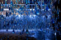 "Luzinterruptus fills 3,000 giant condoms with blue ""rain"" for Totally Thames"