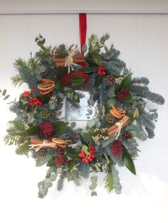 spruce and eucalyptus, foliages, green pine needles trimmings, cinnamon sticks and orange slices. Orange Christmas Tree, Christmas Flowers, Christmas Tree Farm, Christmas Mood, All Things Christmas, Christmas Crafts, Christmas Door Wreaths, Holiday Wreaths, Christmas Centerpieces