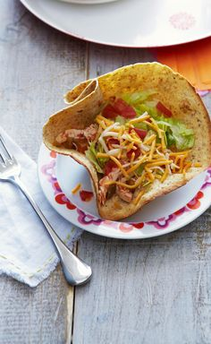 Chicken Tinga Tortilla Cups — This quick riff on Mexican street food has lettuce, tomato, salsa and shredded chicken in crunchy tortilla cups for the kind of flavor kids eat up.