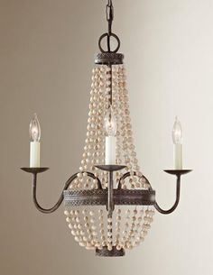 The Charlotte mini chandelier from Feiss has a French market feel with strings of unfinished natural wood beads and its small size makes it ideal for a bath, bedroom, closet or small foyer. TM 4010. www.feiss.com