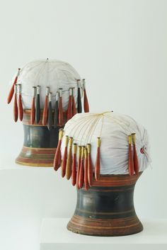 Gathaa Fai Pillow. Pillow stand and bobbins used to make ribbon and embroidery for women's dresses. In the olden days before the time of synthetic threads, gold and silver were molten to spin into threads to be used make ribbons. The collar and handcuff pieces were used in multiple times when the dresses were worn out.