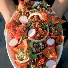Chilaquiles (Salsa-Simmered Tortillas) Recipe - Saveur.com