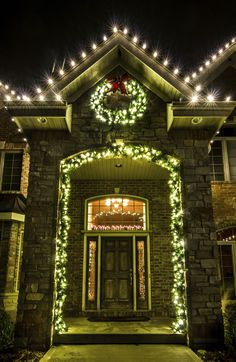 Holiday Christmas lights and Garland- The perfect touch to a beautiful entryway. Add some holiday lights to give your home a welcoming glow all night long. Holiday Lights, Christmas Lights, Christmas Holidays, Outdoor Christmas Garland, The Perfect Touch, Favorite Holiday, Entryway, Glow, Traditional