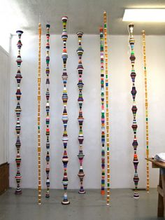 "Mary Ellen Croteau - ""Endless Columns"" - bottle caps and medicine bottles"