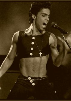 Only Prince could make a swinging cross and gold chains perfectly placed around the waist look so damn sexy ● the Beautiful One ●