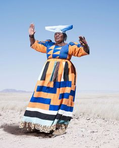 Herero Tribe series by fine art photographer Jim Naughten shot in Namibia. Capturing dramatic portraits in the intensity of the Namibian landscape, the magnificent costume and characters of the tribe are all revealed African Tribes, African Women, African Fashion, Victorian Era Fashion, Victorian Dresses, Victorian Women, African Textiles, Dance Poses, Patchwork Dress