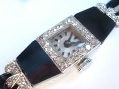 Hey, I found this really awesome Etsy listing at https://www.etsy.com/listing/206753034/art-deco-onyx-platinum-ladies-watch-with