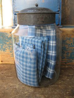 I never thought of keeping dish towels and such in a jar. Good idea for kitchens with few drawers.