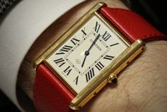 Up close and personal...Cartier Tank LC on red leather. Love it!