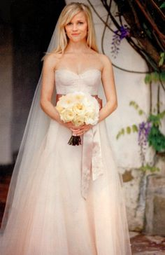 Reese Witherspoon in her light pink wedding dress.  looks like she's wearing a sash around the waist...wish i could see it!  absolute perfection.
