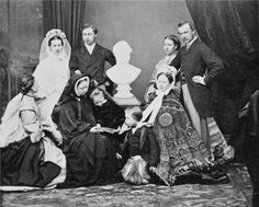 March 1863. The Royal Family is arranged around a bust of Albert, the late Prince Consort. Standing (left to right) - Princess Alexandra of Denmark, Princess of Wales (1844-1925); Prince Albert Edward, Prince of Wales (1841-1910); Princess Helena (1846-1923): Grand Duke Louis of Hesse (1837-1892). In front (left to right) - Princess Alice (1843-1878); Queen Victoria (1819-1901); Princess Beatrice (1857-1944); Prince Leopold (1853-1884); Princess Victoria, Crown Princess of Prussia (1840-1901...