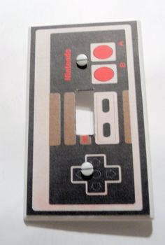 Nintendo Old School Controller Light Switch Cover by myevilfriend,