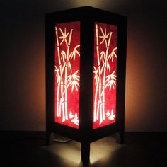 Asian Oriental Red Japanese Bamboo Bedside Floor or Table Lamp or Bedside Wood Paper Light Shades Furniture Home Decor. $15.97, via Etsy.