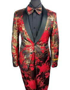 This red and gold floral pattern tuxedo is the perfect tux for prom, or any event where you want to make a statement. It features a luxurious fabric, with a satin shawl lapel. Comes with matching slim flat front pants, and a matching oversized bowtie. #PromTuxedo #Tuxedo #RedTuxedo #WeddingTuxedo #PromTux #WeddingTux #Tux #Wedding #Prom