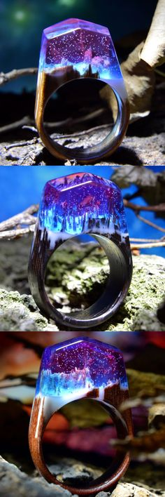 A set of galaxy rings made of wood and jewelry resin