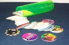 POGS. I was like 13 & already out of toys & more involved w/ my BF by then, but I remember if I wanted 2 make my younger brother mad, all I had 2 do was empty these things from it's container. lol!