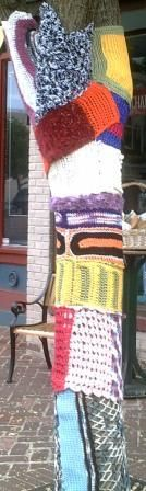Crochet & Knitting at the FiberArts Cafe.  Another view of our yarn bombed tree out front, July 2012.