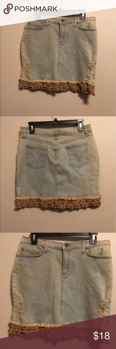 Moda International distress vintage denim skirt This has tan soft suede trim with 0 brass rings in trim . Denim has distress on sides of skirt . Waist is 16 inches. Length is 17 inches. NWOT Moda International Skirts Mini