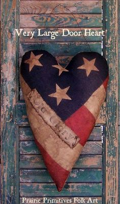 Heart door hanger made from vintage American flag. Stamped banner can be removed, if desired.