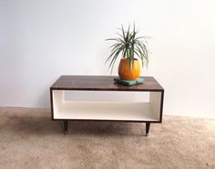 Mid Century Modern Coffee Table in Chocolate and White  Coffee Table Pictured L 32 x W 16 x H 16 Shelving Space: 8.5 x 16  This handcrafted Mid Century Modern coffee table is made from Pine Select. Its finished with homemade stain and several protective coats of satin polyurethane. This piece can easily be customized to the size and color combination you choose!  This coffee table is a custom order and will be shipped in 4-6 weeks of payment. Variations of colors are welcomed along with…