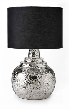 Pierced nickel table lamp The contrast of a black shade and silver base make this table lamp a standout accessory. We love the intricate detail in the bright silver base. This gorgeous lamp makes the perfect accent piece for a living room or bedroom. $59.99, HomeSense.