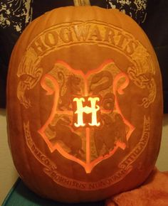 Ooh, I want one of these! Hogwarts Crest Pumpkin