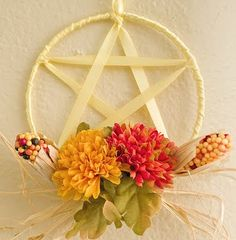beautiful pentacle wreath with seasonal accents. (the pentagram is a positive symbol in paganism, not evil)