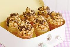 Whether it's school fete time, or you need to whip something up for a cake stall, this collection of sweet treats will sell like, well, hot cakes! Cooking Chocolate, Melting Chocolate, Popcorn Cones, Yummy Treats, Sweet Treats, Fete Ideas, Party Ideas, Cake Stall, School Cake