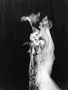 Their locked gaze adds such a beautiful depth of romance to this 1920s wedding photo.