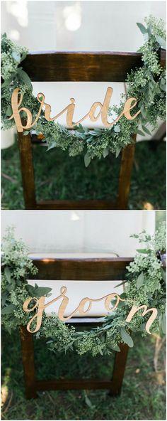 Chair décor, sweetheart table, seeded eucalyptus, garland, gold bride & groom sign // Kristine Marie Photography #weddingdecoration