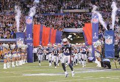 Patriots take the field during Super Bowl XLVI