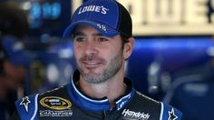 TALLADEGA, AL - OCTOBER 17:  Jimmie Johnson, driver of the #48 Lowe's Chevrolet, stands in the garage area during practice for the NASCAR Sprint Cup Series GEICO 500 at Talladega Superspeedway on October 17, 2014 in Talladega, Alabama.  (Photo by Todd Warshaw/Getty Images)