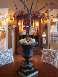 Fall decorating at Sugar Pie Farmhouse...love that urn! Hang fall theme ornaments on the branches!