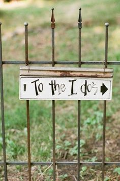 """To the I Dos"" sign for an outdoor wedding."