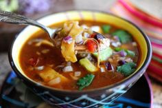 Chicken Tortilla Soup - The Pioneer Woman (Made for dinner ~ Very good!)  Changes I made: Used 1 can Hot Rotel, 1 can of Original Rotel, Only used 1 can of beans, added 1 can corn (drained), 1 diced jalapeno to the onions/green peppers and added 1TB of caldo de pollo to the broth.  Also I baked my tortilla strips, spray with Pam and season - bake @ 400 for 12 minutes (broil to help get them crispy)