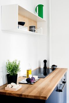 Reform Basis 01 kitchen with black and white painted fronts and a table top in…