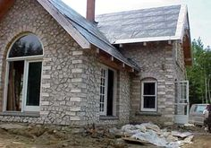I love the rounded windows! Cordwood Homes