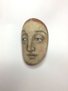 Virginia Woolf on river rock by artist kaveman