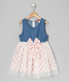 Flouncing with all the fun of being young, this frock features a darling denim bodice paired with a pretty polka dot skirt with a tulle overlay and a big, beautiful bow at the stretchy waistband. Thanks to cotton fabric and a zipper in back, it's as comfy as it is sweet.