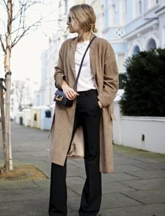 Suede camel coat, flared pants and a pointed boot on Fashion Me Know   Fashiolista.com