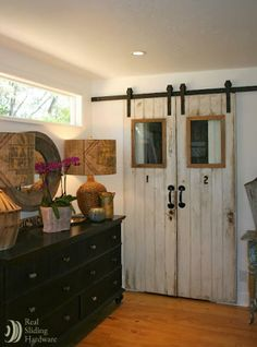 two old doors + barn door hardware = fantastic closet doors! much much nicer than regular old sliding doors! love this idea! Decoration Palette, Sliding Closet Doors, Pantry Doors, Wardrobe Doors, Entryway Closet, Sliding Wardrobe, Vintage Doors, Old Doors, Interior Barn Doors