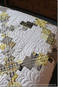 Catawampus Quilt with feathered centers.