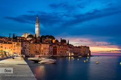 The city of Rovinj at twilight Croatia Rovinj/Rovigno is a city in my country Croatia situated on the north Adriatic Sea. Located on the western coast of the Istrian peninsula it is a popular tourist resort and an active fishing port. It is famous for its beautiful sunsets.