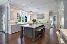 Island in different colour. Nice marble. White Kitchen With Dark Wood Floor Designs from /hgsphere/