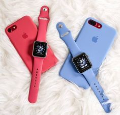 Red iphone 7 and red and blue apple watch strap and apple watches
