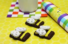 Cute bumblebee chocolate cookie, yellow frosting stripes and yogurt covered pretzel