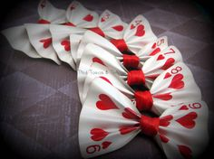 M's custom set of 8 Playing Card Bowties on pins, Lower numbers and an Ace of hearts with red centers. Place your custom order, can be made on hair clips or pins!