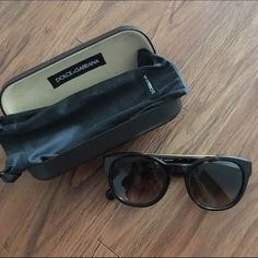 Dolce & Gabanna new sunglasses Bought about a month ago, worn many times but still in perfect condition. High name brand. Comes with case and cloth bag. Glasses are almost brand new with gold piece across the top and brown/black tortoise design. Very trendy and high fashion. Selling for a lot less than bought. Dolce & Gabbana Accessories Sunglasses