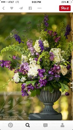large tabletop urn arrangement with purple, green and white